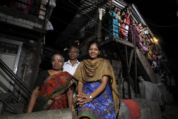 Prema Jayakumar, right, with her mother Lingammal and father Jayakumar near her chawl in Malad, Mumbai. Photo: Abhijit Bhatlekar/Mint