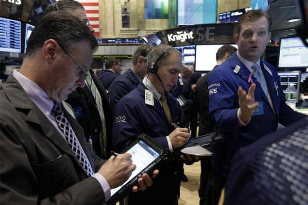 Traders at the New York Stock Exchange on Wednesday. Photo: AP