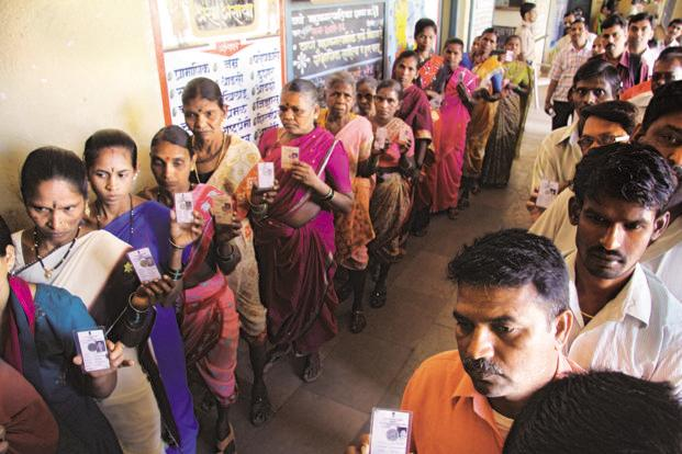 A file photo of people voting in Thane, Maharashtra. The survey has been conducted by ABP News-Nielsen in 28 cities among 9,000 people across the country. Photo: Hindustan Times