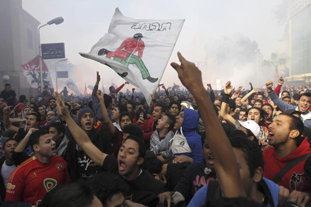 Al Ahly fans celebrate after hearing the final verdict of the 2012 Port Said massacre in Cairo on Saturday. Photo: Amr Abdallah Dalsh/ Reuters