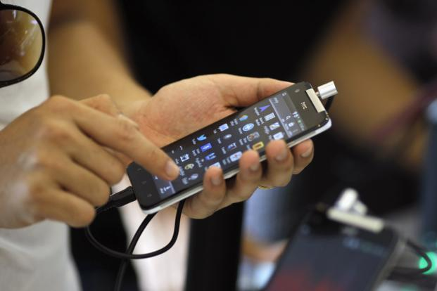 An October 2012 Gartner report forecast that by 2013, mobile phones will overtake personal computers, or PCs, as the most common Web-access device worldwide and that, by 2015, over 80% of the handsets sold in mature markets will be smartphones. Photo: Reuters