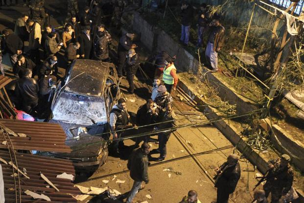 Security policemen inspect a damaged car in the suburbs of Beirut on Monday. It was not immediately clear what the target of the bomb was but the car was parked near a office for Shi'ite Hezbollah-aligned Amal political group. Photo: Reuters