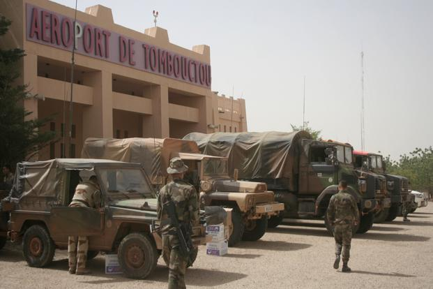 French military personnel gather outside the airport at Timbuktu in Mali on Thursday. Photo: AP (AP)