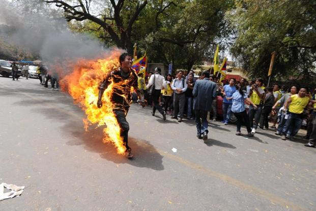 A file photo of a Tibetan exile engulfed in flames after he set himself on fire during an anti-China protest. Nearly 100 Tibetans have set themselves on fire apparently to signal their discontent with Beijing. Photo: AFP