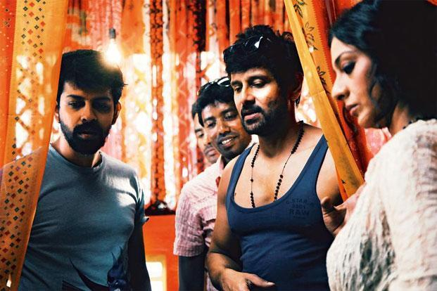 Nambiar (left) directs Vikram and Tabu.