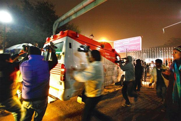 Scenes of an ambulance, supposedly carrying the victim of the Delhi gang rape, were flashed on TV news channels. Photo: Raj K Raj/Hindustan Times.