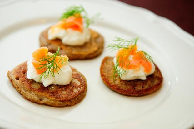 Garnish buckwheat blini with sour cream, smoked salmon and dill. Photo: Photo: Priyanka Parashar/Mint.
