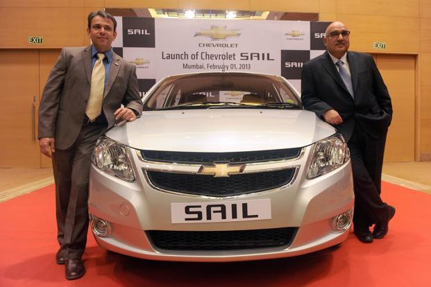 Yudhvir Singh (Left) and Anil Mehrotra of General Motors pose with the new Chevrolet Sail sedan motor-car during the launch in Mumbai on Friday. Photo: AFP