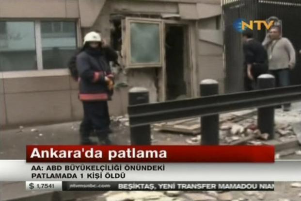 In this image made from video, emergency personnel are seen in front of a side entrance to the US Embassy following a blast in Ankara on Friday. Photo: AP