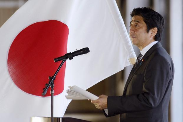 Japanese Prime Minister Shinzo Abe delivers a speech in front of the members of Japan Air Self-Defense Force in its Naha base, Okinawa, southern Japan on Saturday. Photo: AP