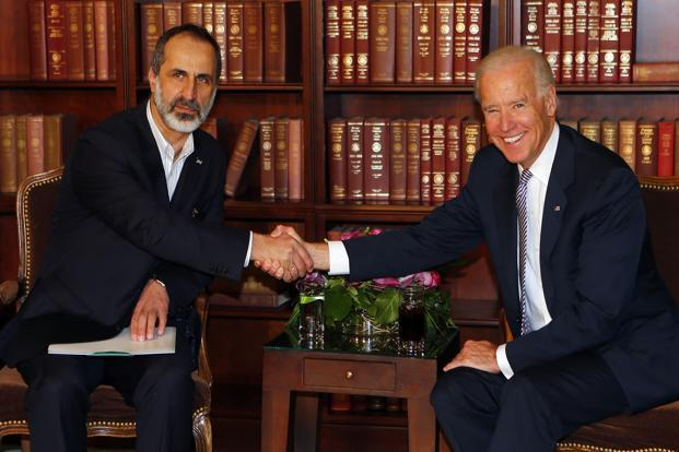Sheikh Moaz Alkhatib, president, National Coalition of Syrian Revolutionary and Opposition Forces (left) and US vice-president Joe Biden meet for bilateral talks in Munich. Photo: Reuters