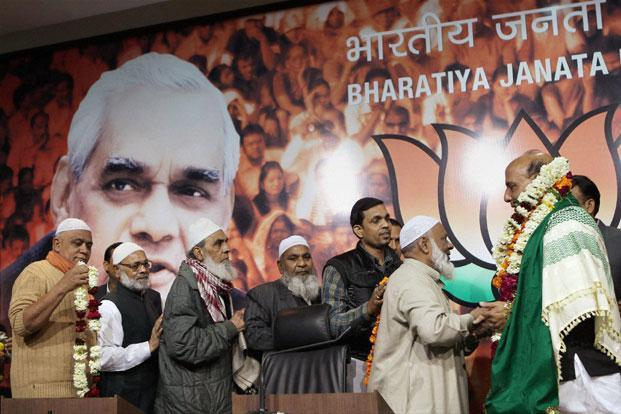 Muslim supporters felicitate BJP chief Rajnath Singh at a function in New Delhi on Saturday. Photo: PTI