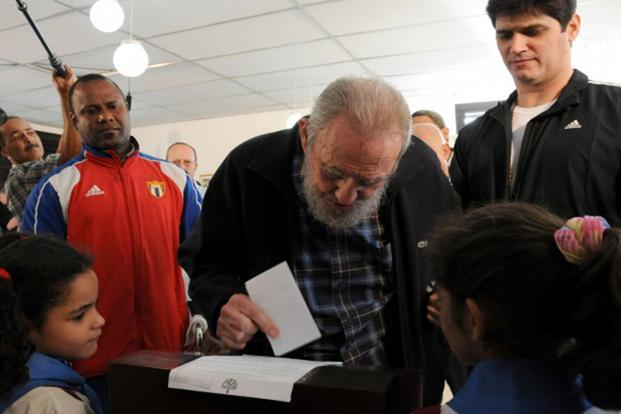 Former Cuban leader Fidel Castro, centre, casts his ballot at a polling station in Havana on Sunday.Photo: Reuters