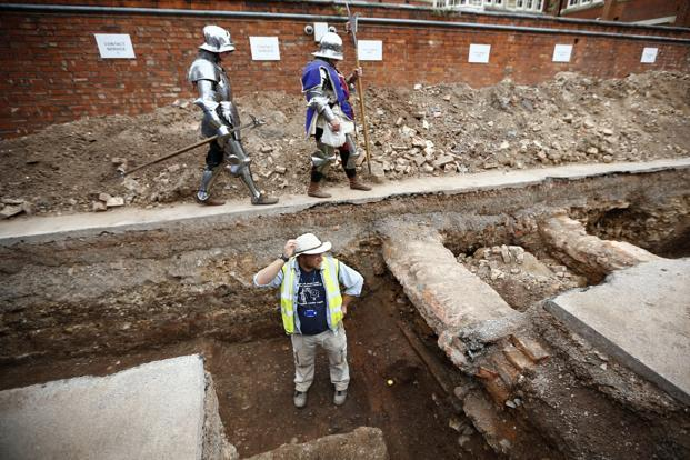 A September photo of archaeologist Mathew Morris standing in the trench where he found skeleton remains during an archaeological dig to find the remains of King Richard III in Leicester, central England. Photo: Reuters