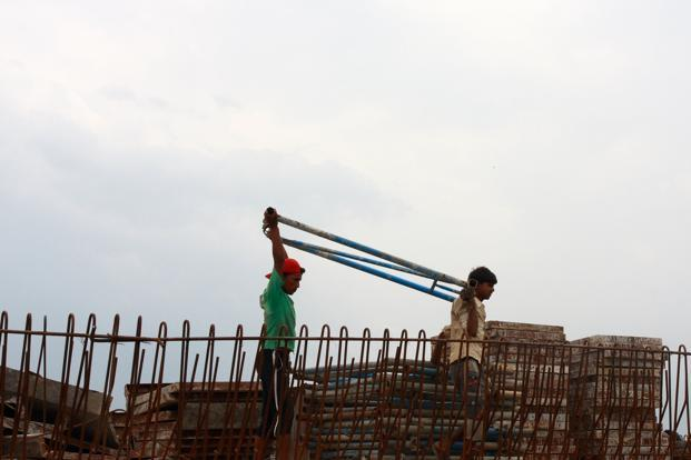 A file photo of migrant workers at a construction site in Kochi. Photo/Sivaram V/Mint