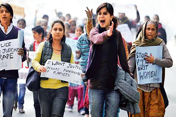 A file photo of people protesting against the gang rape of a woman in New Delhi. Photo: Hindustan Times