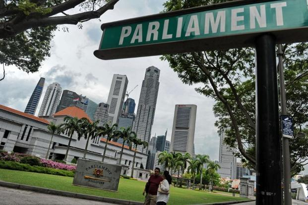 Singapore should target subsidies at the lower income quartile, continue to welcome skilled immigration, allow the currency to appreciate to raise service sector productivity, communicate its policy to the public better and hope for the best. Photo: AFP