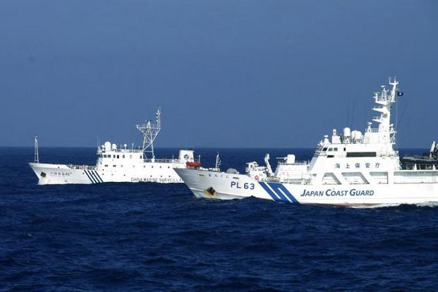 A handout picture taken by the Japan Coast Guard on 4 February shows a Chinese marine surveillance ship (left) alongside a Japan Coast Guard ship near the disputed islets known as the Senkaku islands in Japan and Diaoyu islands in China, in the East China Sea. Photo: AFP