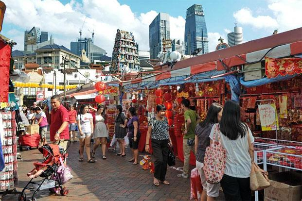 A file photo of people walking through a street in Chinatown of Singapore. Photo: AFP