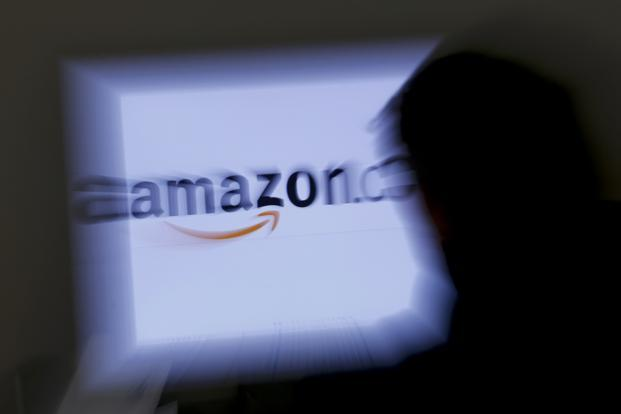 Amazon is providing added incentive for developers by promising to give away tens of millions of dollars in Amazon Coins for people to spend when the virtual currency is introduced. Photo: Reuters