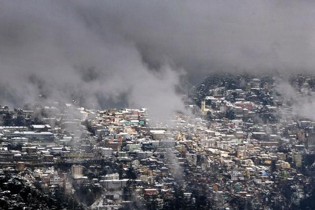 A view of snow-covered buildings in the town of Shimla, the capital of Himachal Pradesh state, on Wednesday. A rescue operation was launched despite the heavy snowfall in the tribal region bordering Tibet. Photo: AFP.