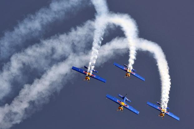 Members of The Flying Bulls aerobatics team from the Czech Republic fly in formation in their Zlin Z-50 aircraft during Aero India 2013 at the Yelahanka Air Force station in Bangalore on Wednesday. AFP