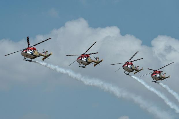 The Indian Air Force Sarang aerobatics team perform in their HAL Dhruv helicopters. AFP