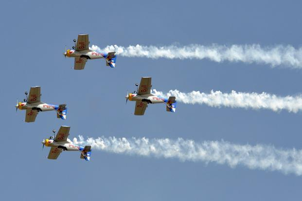 Red Bull's Zlin 50LX single-engine and single-seater planes perform during the show. Reuters