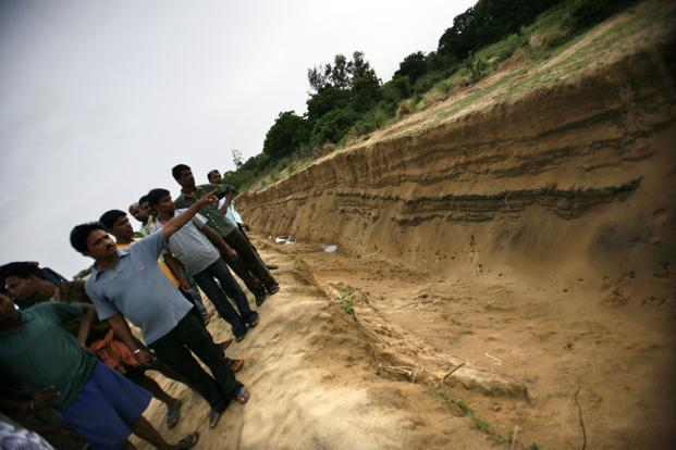 On the land that has already been acquired by the state government, villagers and workers show the drain and a boundary wall being built at Polang for the Posco Steel project. Photo: Mint
