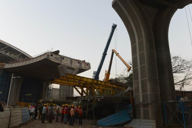 Workers at the site of an under-construction bridge collapse at the Chhatrapati Shivaji International Airport in Mumbai on Thursday. Photo: AFP