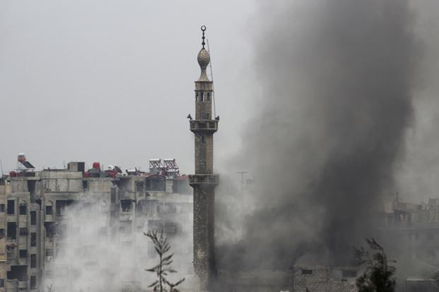 Smoke rises from a mosque during heavy fighting between the Free Syrian Army and President Bashar al-Assad's forces, in the Jobar area of Damascus on Wednesday. Photo: Mohamed Dimashkia/Reuters