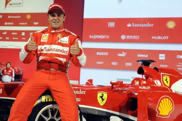 A file photo of Ferrari Formula one driver Felipe Massa posing with the new Ferrari F138 during its unveiling in Maranello. Photo: AFP