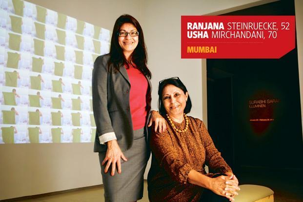 Ranjana Steinruecke and Usha Mirchandani at their gallery. In the backdrop is a video installation from the show 'Illuminen' by San Francisco-based artist Surabhi Saraf. Photo: Abhijit Bhatlekar/Mint.
