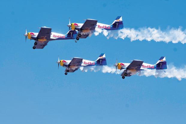 The Flying Bulls team from the Czech Republic performing aerobatics at Aero India 2013.