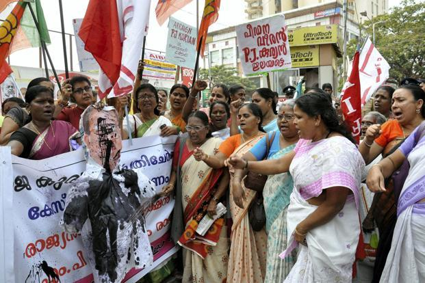 Women activists staging a Protest, demanding resignation of P.J. Kurien, deputy speaker of state's upper house, for alleged involvement in Suryanelli rape case, in front of the Kerala High Court at Kochi on Thursday. Photo: PTI