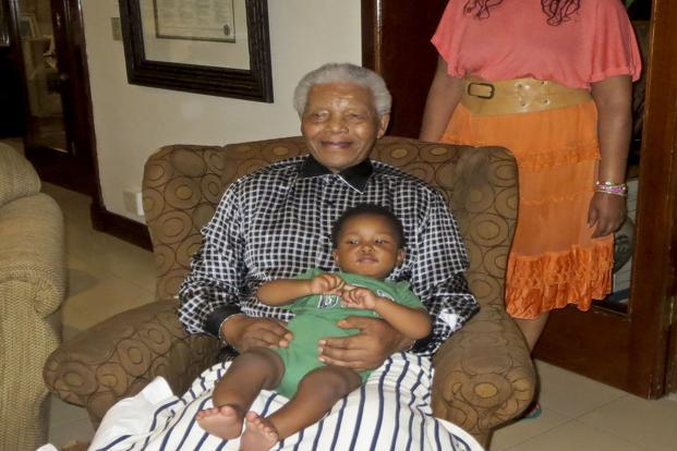 A 2 February photo of former South African president Nelson Mandela with his great grandson Zen Manaway in Johannesburg, South Africa. The 13-episode first season follows Zaziwe Dlamini-Manaway and Swati Dlamini—granddaughters of Mandela and Winnie Madikizela-Mandela—as they try to carry on the family legacy while juggling motherhood in Johannesburg. Photo: AP