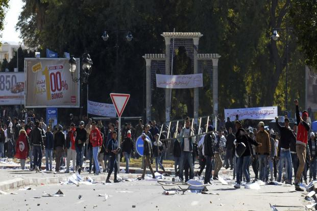 Police fired teargas to scatter protesters near the interior ministry in Tunis and stone-throwing youths in the southern mining town of Gafsa, where at least seven were injured, as unrest erupted over the killing of secular politician Chokri Belaid. Photo: Reuters