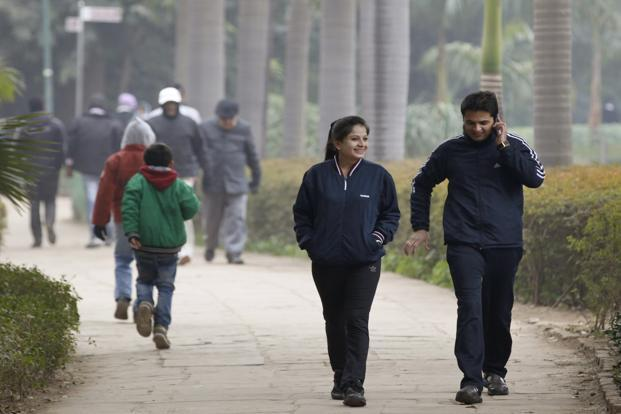 People walk in a cold morning in New Delhi. Photo: Hindustan Times
