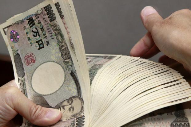 The current account is expected to improve gradually as a weak yen boosts exports, but some economists say the benefits may not appear until the second quarter of this year. Photo: AFP