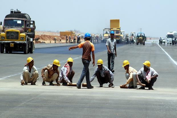 A file photo of labourers working at Rajiv Gandhi International Airport at Shamshabad, on the outskirts of Hyderabad, which is operated by GMR Hyderabad International Airport Ltd. Photo: AFP