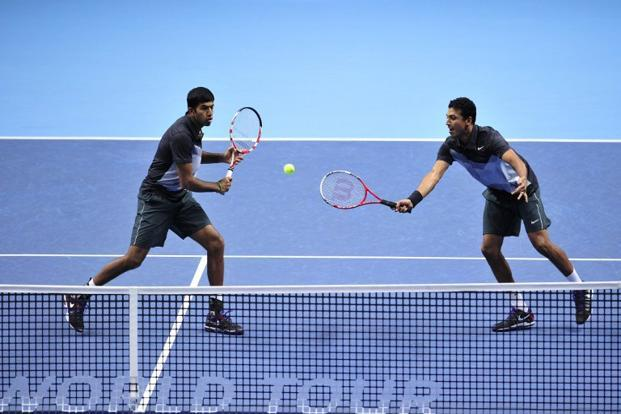 A file photo of Rohan Bopanna (L) and Mahesh Bhupathi during the doubles final against Spain's Marcel Granollers and Spain's Marc Lopez at the ATP World Tour Finals tennis tournament in London on 12 November 2012. Glyn Kirk/AFP.