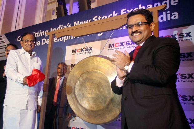 Finance minister P. Chidambaram (left) strikes a gong during the launch of MCX-SX in Mumbai. Photo: PTI