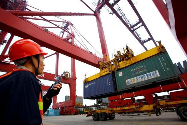 US exports and imports of goods last year totaled $3.82 trillion, the US commerce department said. China's customs administration reported last month that the country's trade in goods in 2012 amounted to $3.87 trillion. Photo: AFP
