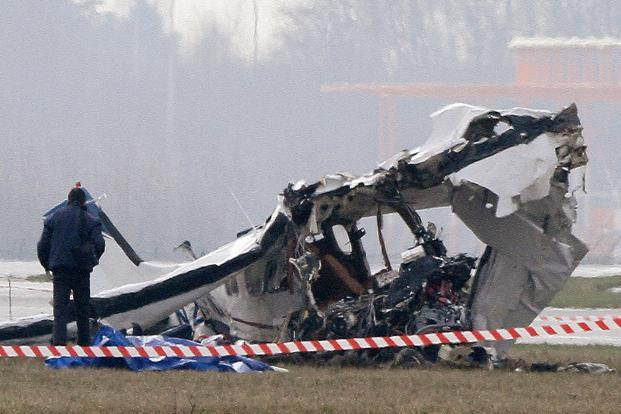 A police photographer inspects the scene of a tourist plane crash at Charleroi airport in Belgium. Photo: Reuters