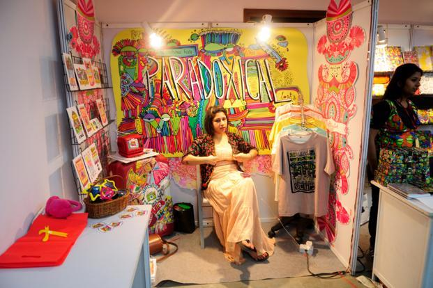 Angel Bedi, one of the artists participating at Comic Con had set up a stall where people could click pictures against the backdrop
