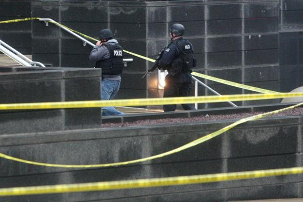 Armed police officials entering the New Castle county courthouse. Photo: William Bretzger/AP