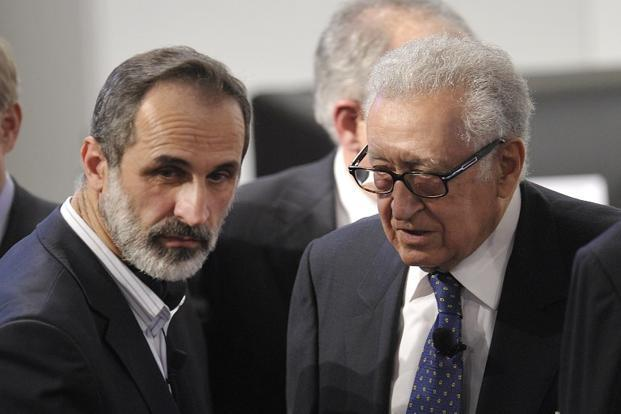 UN envoy Lakhdar Brahimi (right) talks with Syrian opposition leader Sheikh Moaz Al-Khatib. Photo: AFP