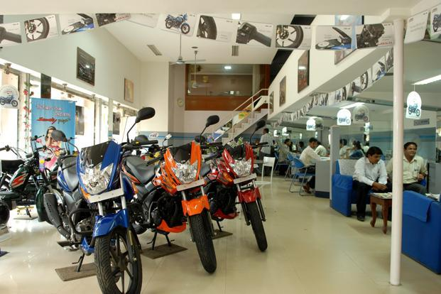 A file photo of TVS's showroom in Bangalore. In the next seven months, TVS will launch one executive-class bike and two scooters, a category in which it has been losing out to Honda. Photo: Hemant Mishra/Mint