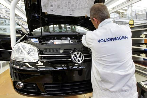 A worker checks a Volkswagen Golf model on a production line at Volkswagen's manufacturing plant in Wolfsburg. Photo: AFP