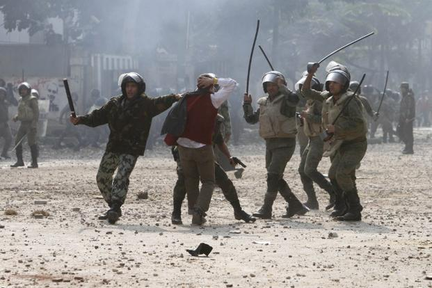 Egyptian soldiers beat a protester near Tahrir Square. Photo: AFP